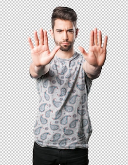 Young man stop gesture
