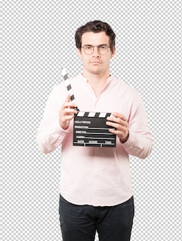 Young man using a clapperboard