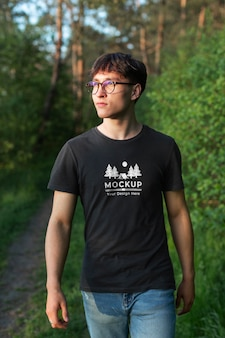 Young man wearing a mock-up t-shirt in the nature