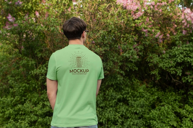 Young man wearing a mock-up t-shirt outdoors