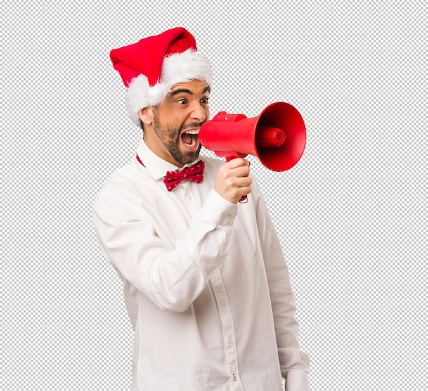 Young man wearing a santa claus hat on christmas day