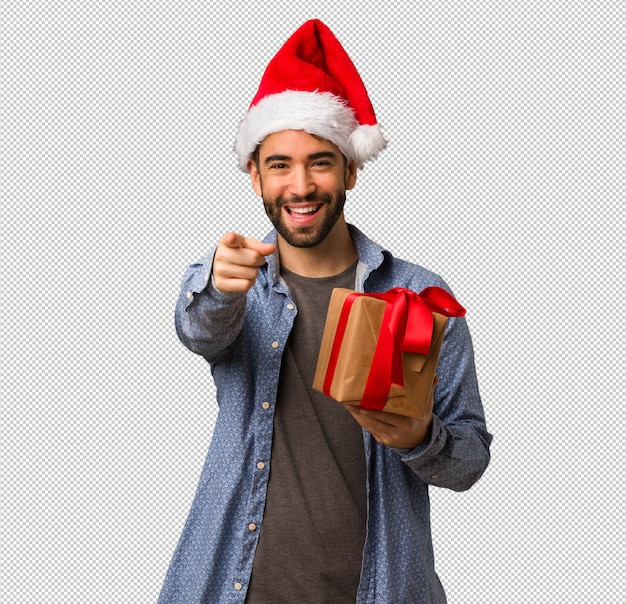Young man wearing santa hat cheerful and smiling