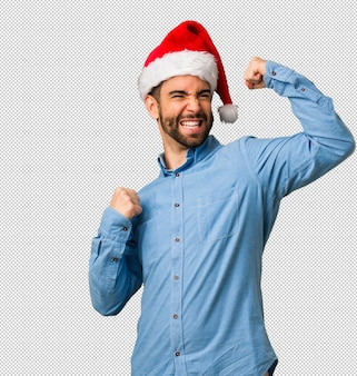 Young man wearing santa hat who does not surrender
