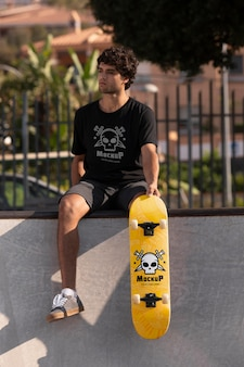 Young man with mock-up skateboard