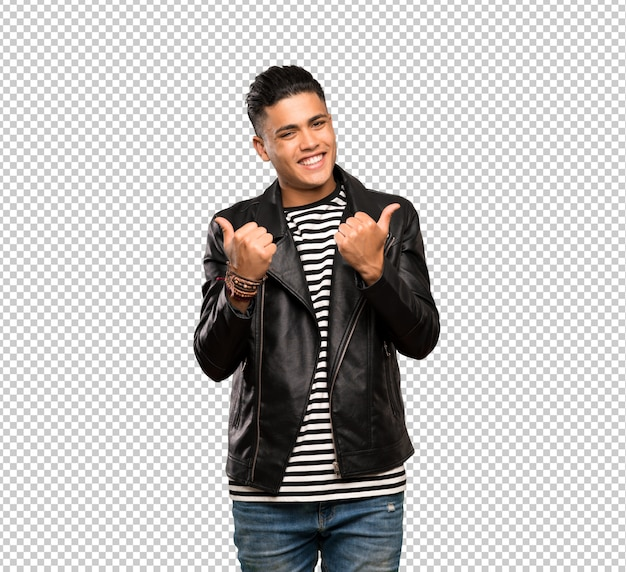 Young man with thumbs up gesture and smiling