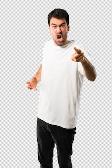 Young man with white shirt annoyed angry in furious gesture.