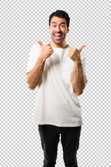 Young man with white shirt giving a thumbs up gesture with both hands and smiling