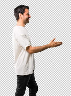 Young man with white shirt handshaking after good deal