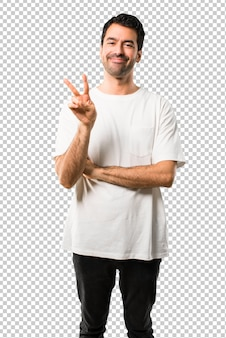 Young man with white shirt happy and counting two with fingers