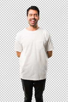 Young man with white shirt makes funny and crazy face emotion