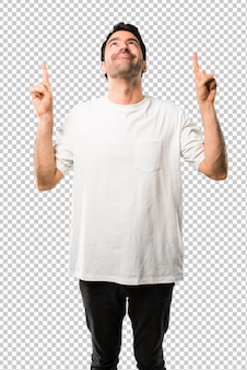 Young man with white shirt pointing with the index finger a great idea and looking up