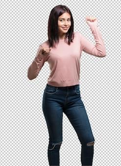 Young pretty woman dancing