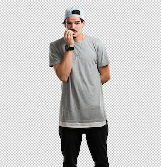 Young rapper man biting nails, nervous and very anxious and scared for the future, feels panic and stress