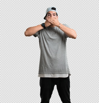 Young rapper man covering mouth, symbol of silence and repression, trying not to say anything