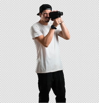 Young rapper man excited and entertained, looking through a film camera