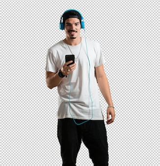 Young rapper man happy and fun, listening to music, modern headphones, happy feeling the sound and rhythm