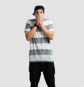 Young rapper man very scared and afraid, desperate for something, cries of suffering and open eyes, concept of madness