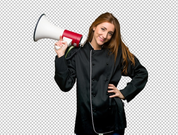 Young redhead chef woman holding a megaphone