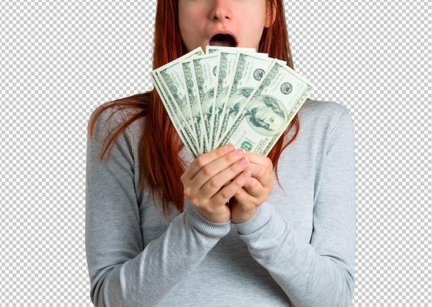 Молодая рыжая девочка, много денег