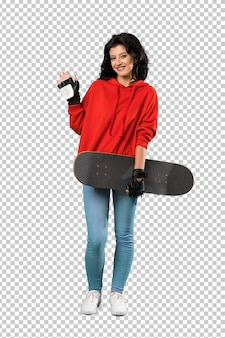Young skater woman saluting with hand with happy expression