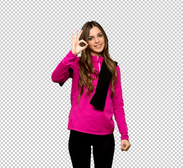 Young sport woman showing an ok sign with fingers