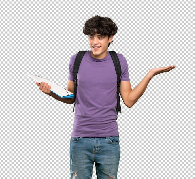 Young student man holding copyspace with two hands
