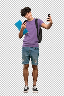Young student man making a selfie