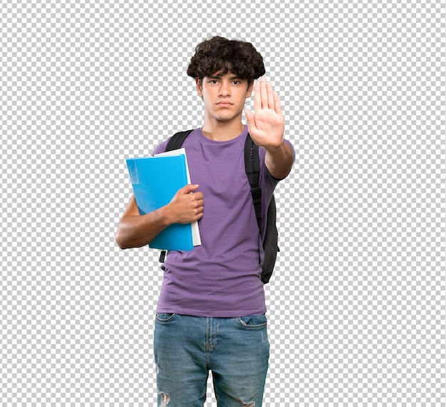 Young student man making stop gesture