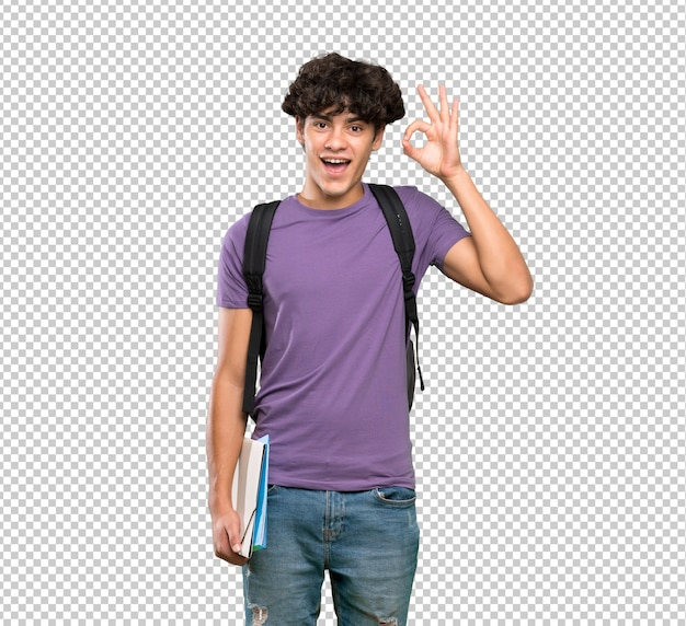 Young student man surprised and showing ok sign