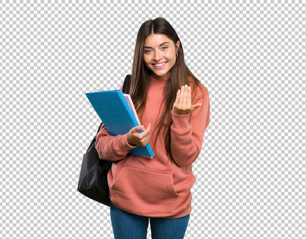 Young student woman holding notebooks inviting to come with hand. happy that you came
