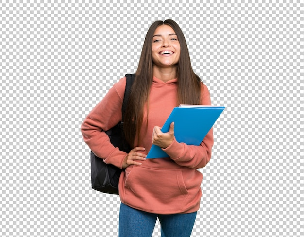 Young student woman holding notebooks posing with arms at hip and smiling