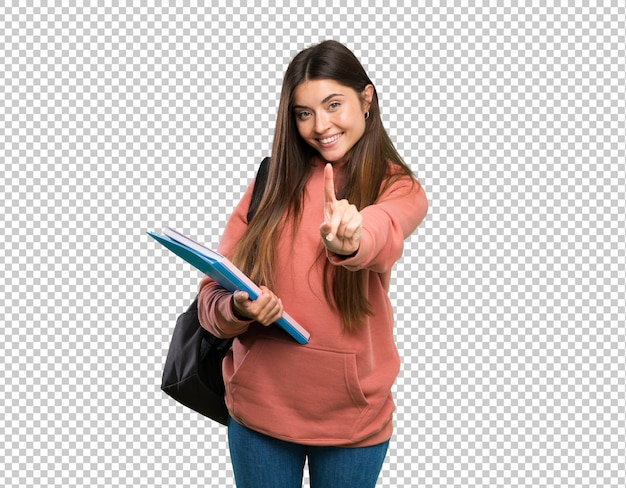 Young student woman holding notebooks showing and lifting a finger