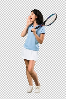 Young tennis player woman shouting with mouth wide open