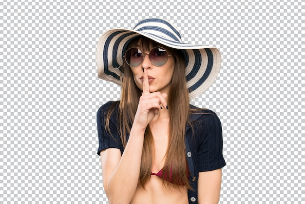 Young woman in bikini doing silence gesture