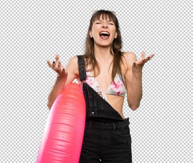 Young woman in bikini smiling a lot