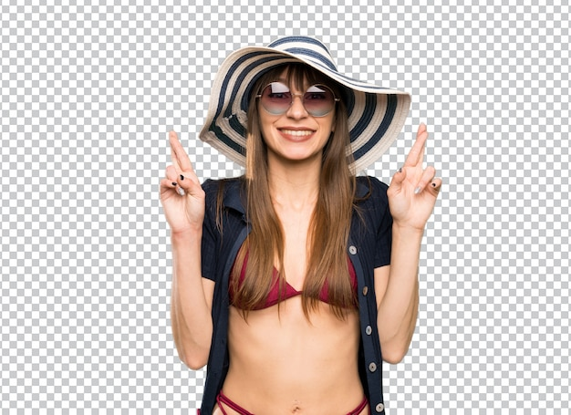 Young woman in bikini with fingers crossing