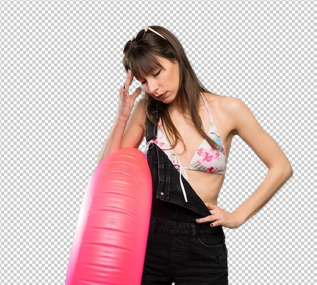 Young woman in bikini with headache