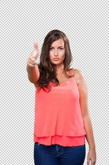 Young woman doing a gun gesture