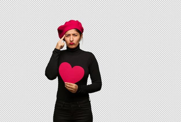 발렌타인 데이 집중 제스처를 하 고있는 젊은 여자