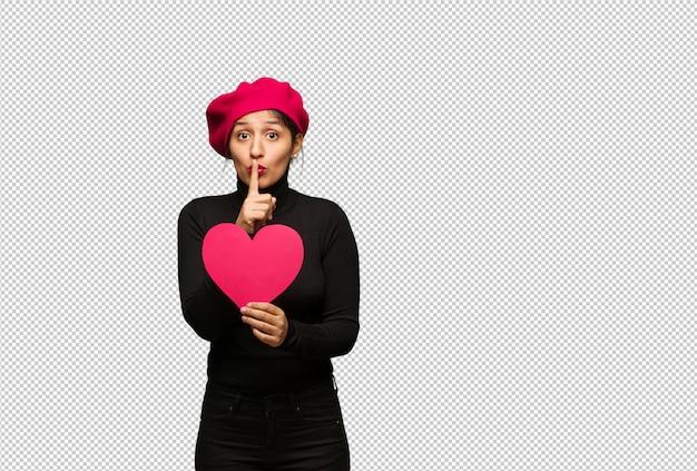 秘密を守るか沈黙を求めるバレンタインデーの若い女性
