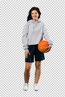 Young woman playing basketball smiling a lot