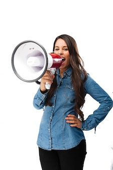 Young woman shouting with a megaphone