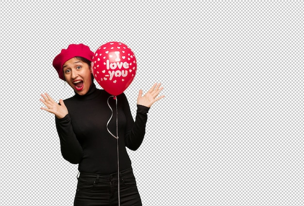 Young woman in valentines day celebrating a victory or success