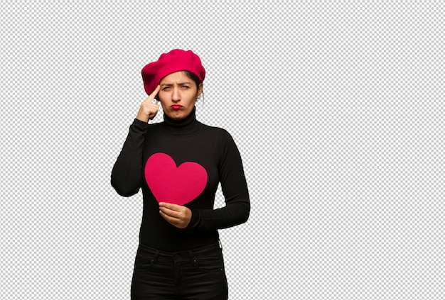 Young woman in valentines day doing a concentration gesture