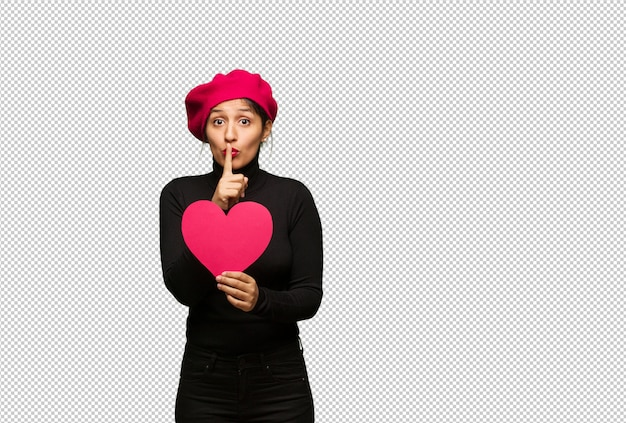 Young woman in valentines day keeping a secret or asking for silence