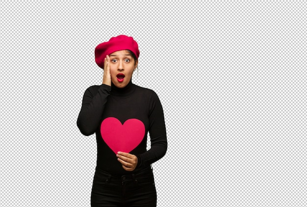 Young woman in valentines day surprised and shocked