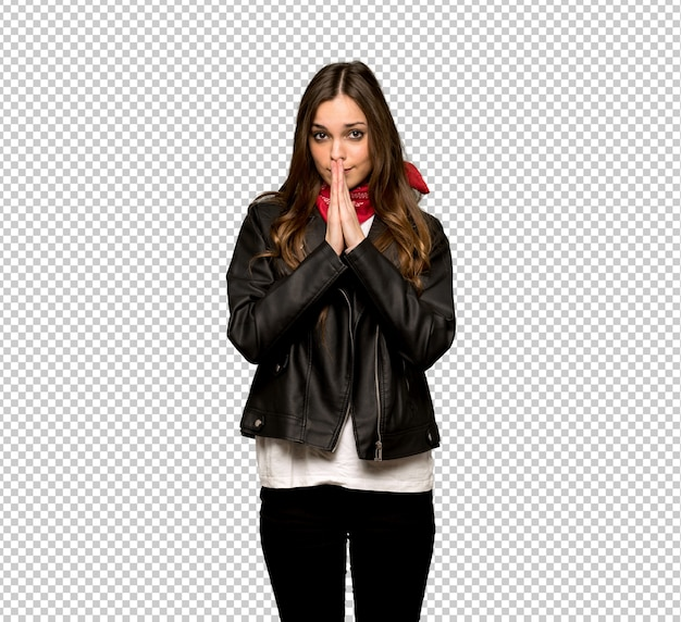 Young woman with leather jacket keeps palm together. person asks for something