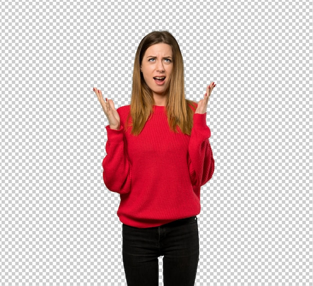 Young woman with red sweater frustrated by a bad situation