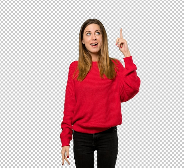 Young woman with red sweater intending to realizes the solution while lifting a finger up