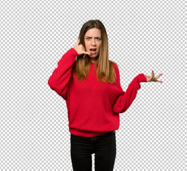 Young woman with red sweater making phone gesture and doubting